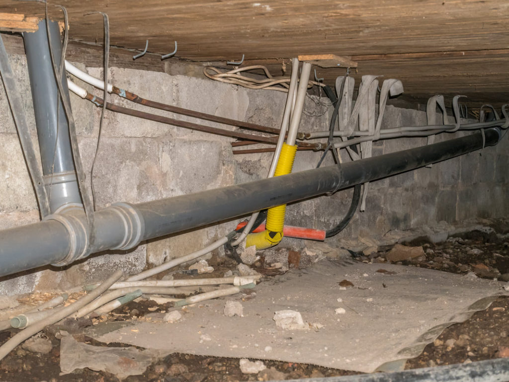 This Is A Picture Of A Crawl Space With Plumbing Pipes After Some Were Replaced By Homeowner And The Erie Pa Plumbers Will Replace The Rest